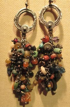 by Susan from Journey Talismans Designs | Earrings; oxidized sterling hoops with ancient Roman beads hanging from sterling chain. The Roman beads are from the time period 100-400AD and are a mix of etched carnelian, lapis, turquoise, coral, faience, shell, amethyst, amber, pottery, stone, silver spacer beads, etc.  {SOLD}