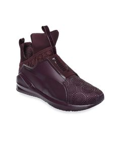 These uber-cool trainers from Puma will be your perfect partners at the gym. Team them with a boxy tee and tights to sweat stylish.  Training shoes,Puma,luxury trainers,stylish trainers,burgundy shoes,textured Puma shoes,textured shoes,burgundy training shoes,shoes for gym