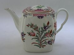 Worcester porcelain teapot and cover; square barreled pot and cover painted in overglaze enamels, polychrome floral and all borders; colours of purple, pink, brown/tan, two shades of green, gilt highlights on large flower sprays; brown band on rims and tip of spout; c1780  Materials: porcelain  Measurements: 127 (height)  Accession number: NWHCM : 1992.226.1912