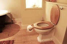 Creative seat Amusing Bog Standard Oak Toilet Seat With Roll Holder by Henry Franks