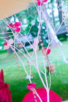 White and fuchsia crystal orchid tree centerpieces.