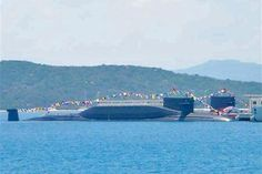 China's Type 094 submarines at base in Hainan.China estimated to have 4 Type 094 Jin-class 2nd-generation ballistic missile submarines.Together,can carry 48 JL-2 submarine-launched ballistic missiles & 200 nuclear warheads,which is 35% of China's nuclear arsenal.With attack range of 6,000 kilometers,JL-2 missile's threat to American forces confined to Western Pacific.China developing Type 096 Tang-class ballistic missile submarines to replace Type 094 by 2020.