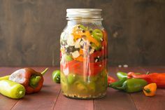 A quick recipe for making pickled peppers that you can keep in your refrigerator for months. They're perfect for topping sandwiches, tacos, tossing onto pizzas, or munching right out of the jar. Jar Recipes, Chili Recipes, Quick Recipes, Sauce Recipes, Pickled Pepper Recipe, Basic Brine, Types Of Peppers, Homemade Ranch Seasoning, Refrigerator Pickles