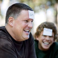 """Family Reunion Ideas Who Am I?  Simply write the names of everyone at the reunion on small slips of paper and drop them in a hat. Then have each player draw a name and tape it to someone else's forehead — without allowing him to see it. Players mix and mingle, asking other participants yes-or-no questions (""""Do I have kids?"""" """"Am I taller than you?"""") until everyone figures out whose name is taped to his or her forehead."""