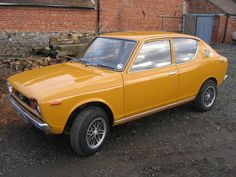 ~ Datsun Cherry 100A; my first car.. same color