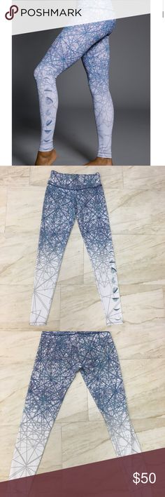 Onzie Luna Graphic Legging A colorful mid rise legging with a design of the moon phases on your calf. Perfect for working out. Onzie Pants Leggings