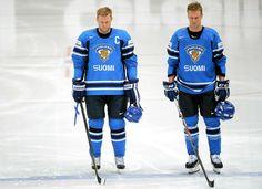 A team in mourning - Silence for Marjamäki - Finland wins for you! (Mikko Koivu and Ossi Väänänen pause for a moment of silence in memory of Pekka Marjamäki, Finnish hockey legend. Finland beats France 7-1), May 10th
