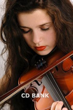Stock photo of Woman playing violin, close-up