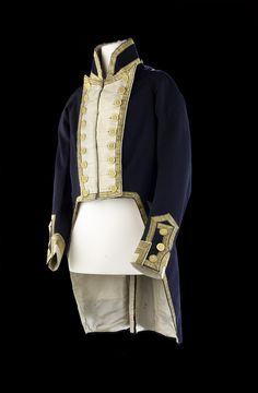 This dress coat of a captain or commander shows the impact of contemporary fashions on uniform. The front is cut straight across in the cutaway style. The lapels are still working, but by this period it was the fashion to stitch them down so they could no longer be unbuttoned. The buttons feature the crown over the fouled anchor which was introduced with the 1812 regulations. Finally, the pocket flaps are non-functional and completely decorative as the pockets are now located in the tails.