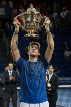 Argentina's Juan Martin Del Potro raises the trophy after winning the final match against Switzerland's Roger Federer during the Swiss Indoors tennis tournament at the St. Jakobshalle in Basel, Switzerland, on Sunday, Oct. 27, 2013. (AP)