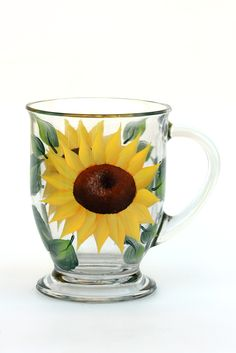 Bright yellow sunflower petals with deep brown centers and deep green leaves hand-painted encircling a 16 oz. quality footed cafe mug.