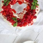 This Christmas wreath pavlova is the perfect meringue dessert for the festive season. A make ahead pudding, light and deliciously topped with cream, fruit and coulis, this is the ideal finish to the meal on the big day!