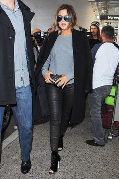 10 Surprisingly Chic Kardashian Outfits From 2014 #refinery29  http://www.refinery29.com/2014/12/79788/kardashian-outfits#slide5  Khloé's airport style is much stronger than ours, but when you boil it down, it's the same staples we wear when we're in transit — a knit sweater, leggings, and oversized sunglasses. The difference is that Khloé plays up key pieces, so she's picture-perfect upon landing. With an A.L.C. pullover, leather leggings, and reflective Victoria Beckham aviators, this ...