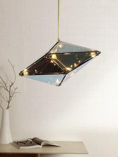 Hedron Luxury Pendant Lamp | Buy Fancy Hanging Lights Online India - The Hedron is a magical hanging light which has a charming effect as it plays with light and reflection when it is turned on. When turned off, the glass surface of the pendant light has a mercurial effect, however when it is turned on, the glass surface becomes translucent, and the lights glow in the form of a constellation Luxury Lighting, Lighting Store, Lighting Online, Cool Lighting, Outdoor Lighting, Room Lights, Hanging Lights, Wall Lights, Ceiling Lights