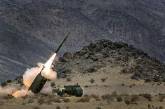 Marines with Sierra Battery, 5th Battalion, 11th Marine Regiment, fire Guided Multiple Launch Rocket Sytems from M142 High Mobility Artillery Rocket System during Exercise DESERT SCIMITAR 2014 aboard #USMC
