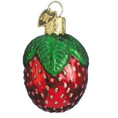 "Sparkling Strawberry Christmas Ornament 28021 Merck Family's Old World Christmas Measures approximately 2"" Made of mouth blown, hand painted glass. In medieval Europe, strawberries"