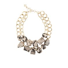I'm lovin' this snake print necklace by BCBG.  It'll pair nicely with a bold blue or even classic navy dress.  But it'll carry it beyond that when paired with a coral, red, black or green dress.