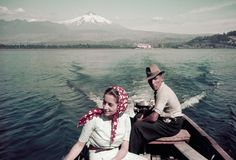 A couple rides in a motorboat on Lake Villarrica in Chile, July 1941.  Photograph by W. Robert Moore, National Geographic