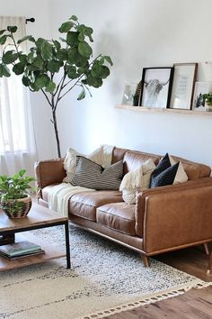 """Timber Charme Tan Sofa - Melissa Rice - Timber Charme Tan Sofa """"The living room is finally almost complete and this sofa is definitely the star of the show."""" The Timber Charme Tan leather sofa will do that. Photo by Lynette Yoder. Boho Living Room, Living Room Lighting, Living Room Sofa, Living Room Furniture, Living Room Decor, Rustic Furniture, Modern Furniture, Ikea Furniture, Living Room Ideas Leather Sofa"""