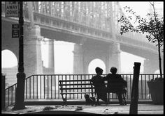Manhattan park bench with view of the bridge and East River