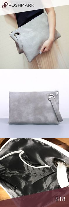 Women's Grey Leather Envelope Clutch/Wristlet For sale is a grey leather envelope clutch/wristlet. Brand new, never used. Two pockets and one zipper pocket in the inside. Feminine yet extremely durable! Dimensions: 12.5 inches across and 8.5 inches tall. 1 inch wide hand/wrist strap.  Selling for $18 but open to any offers. Bags Clutches & Wristlets