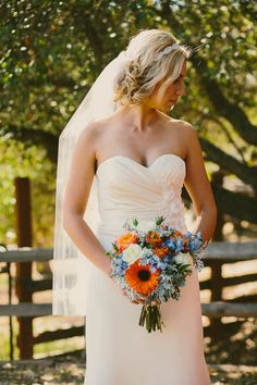 blue, orange, and white bouquet // photo by Hom Photography // http://ruffledblog.com/french-country-inspired-wedding