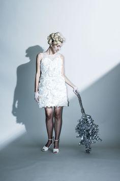 Frill mini dress …多素材のフリルが幾重にも重ねらたミニドレス。 透け感のあるシルクオーガンジーで肩周を軽やかに仕立てました。