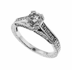A 14k white gold and diamond engagement ring.  The center diamond is a 0.73 carat round brilliant with J color and SI clarity.  There are forty side diamonds equaling 0.40 carats total weight.  Priced: $2,750.  Sale: $2,062.