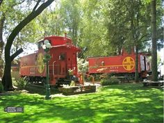 Railway cabooses individually decorated. The railcars all have an incredible view from their park-like setting under centuries-old trees, right on the shore of Lake County's Clearlake area, overlooking the private dock, boat launch and beach. 									                                                                                           ...