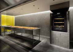 Yota Kakuda creates tiled interior for cheese tart store in Japan