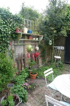 The Nook by HAPPY LOVES ROSIE, via Flickr; love outdoor spaces that feel cozy and inviting like this