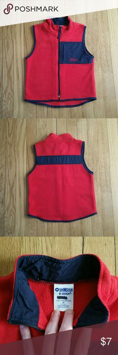 4T OshKosh red fleece vest Size 4T OshKosh B'Gosh red fleece vest, with navy blue trim and details. In very good condition.  Could be worn by boys or girls.   ** See my closet for more great kids clothes. Make a bundle with other size 4 items!  Thx for looking. Osh Kosh Jackets & Coats Vests