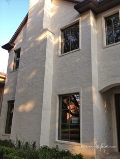 exterior is called a Slurry, basically it's colored mortar troweled over brick. Here's a close-up:
