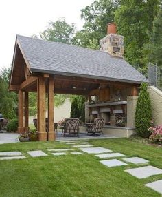 Chunky cedar columns and a tongue-and-groove ceiling lend character to this fireplace nook. Chunky cedar columns and a tongue-and-groove ceiling lend character to this fireplace nook. Backyard Pavilion, Outdoor Pavilion, Backyard Gazebo, Backyard Patio Designs, Backyard Landscaping, Patio Ideas, Pergola Ideas, Wood Pergola, Outdoor Pergola