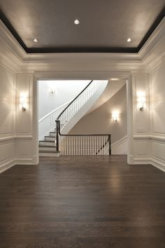 PLD Custom Homes - living rooms - black ceiling, tray ceiling, black tray ceiling, living room paneling, paneled living room, curved staircase, winding staircase,