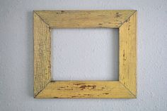 This frame is made of reclaimed wood. Love the color.