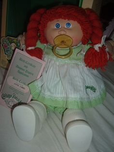 My first cabbage Patch looked just like her! Her name was Delilah I think but I called her Debbie=) I think my mom beat someone up for it!