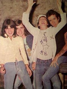 A photo of a very young AC/DC. Angus is wearing a sweet shirt with a cartoon image of his stage persona.
