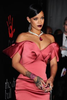 Rihanna wearing Zac Posen gown and Chopard diamond jewelry at the First Annual Diamond Ball for the Clara Lionel Foundation (December 2014). #rihanna