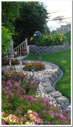 Front wall with round area for rain chain bowl surrounded by plants!