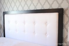 Love this modern tufted headboard - article includes tips for making your own