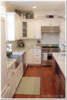 Beautiful kitchen!   The Cottage Market: Cottage of the Week: Finding Home Above Cabinet Decor, Above Kitchen Cabinets, Floors Kitchen, Corner Cabinets, Cupboards, White Farmhouse Kitchens, Cottage Kitchens, Home Kitchens, Farmhouse Chic