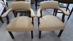 Office Chairs that were a recovered, and the wood was touched up.  http://wardell-upholstery.com/