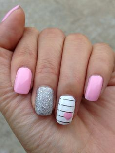 Pink and silver mani for the month of February   L'oreal Penthouse Pink OPI It's Frosty Outside  Essie Blanc Silver nail striping tape
