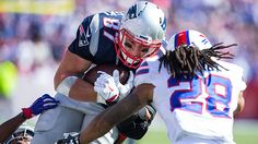Rob Gronkowski of the New England Patriots battles against Ronald Darby and Corey Graham of the Buffalo Bills on September 20, 2015 at Ralph Wilson Stadium. New England defeated Buffalo 40-32.  (Photo by Brett Carlsen/Getty Images)