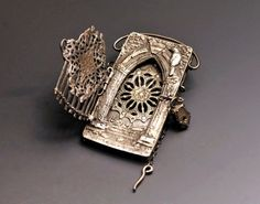 "Sanctuary Guardians Locket by Christi Anderson - ""This 3 way opening hand built locket is made entirely from PMC+. The front gate opens and locks closed with a tiny handmade padlock on a pin."""