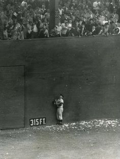 Polo Grounds, Manhattan, NY, October 3, 1951 - The Dodgers Andy Pafko can only look up in agony as Bobby Thomson's 3-run homer clears the left field wall and sends the Giants to the World Series.