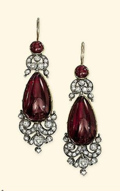 Earrings from a Victorian diamond & garnet demi-parure. Comprising a brooch with garnet cabochon centre within old-cut diamond cartouche-shaped surround suspending a detachable two-stone garnet & diamond pendant; ear pendants en suite, together with diamond and garnet suspension loop & chain for necklace conversion, mounted in silver & gold, adapted, circa 1860.