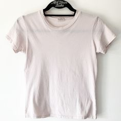 """NWOT 21"""" pastel pink top 21"""" in length. Soft blended cotton top in pastel pink with distressed trimming. Distressing may vary. A tiny fuzzy ball blended in the original fabric on front and light dust stains on right side shoulder Brandy Melville Tops Tees - Short Sleeve"""