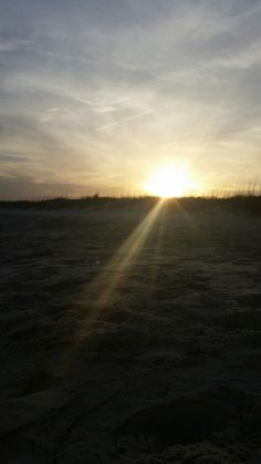 Myrtle beach state park sunset over dunes